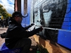 Jerome Gonzalez, of Bridgewater, paints a portrait of Malala Yousafzai, on the side of a building in the 100 block of Walnut Avenue in Trenton's Wilbur Section on Oct. 17, 2015. (Scott Ketterer - The Trentonian)