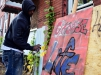 Jeff McCould of Trenton is seen painting a work that will be installed on a building later at the Windows of Soul event in the 100 block of Walnut Avenue on Saturday Oct. 17, 2015. (Scott Ketterer - The Trentonian)