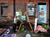 Wills Kinsley, of Trenton's Sage Coalition places various works of art upon a vacant building in the city's Wilbur Section on Saturday Oct. 17, 2015. (Scott Ketterer - The Trentonian)